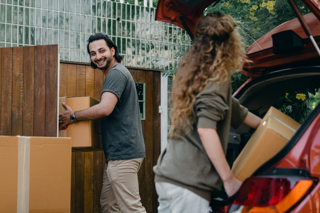 Couple moving their stuff to new house