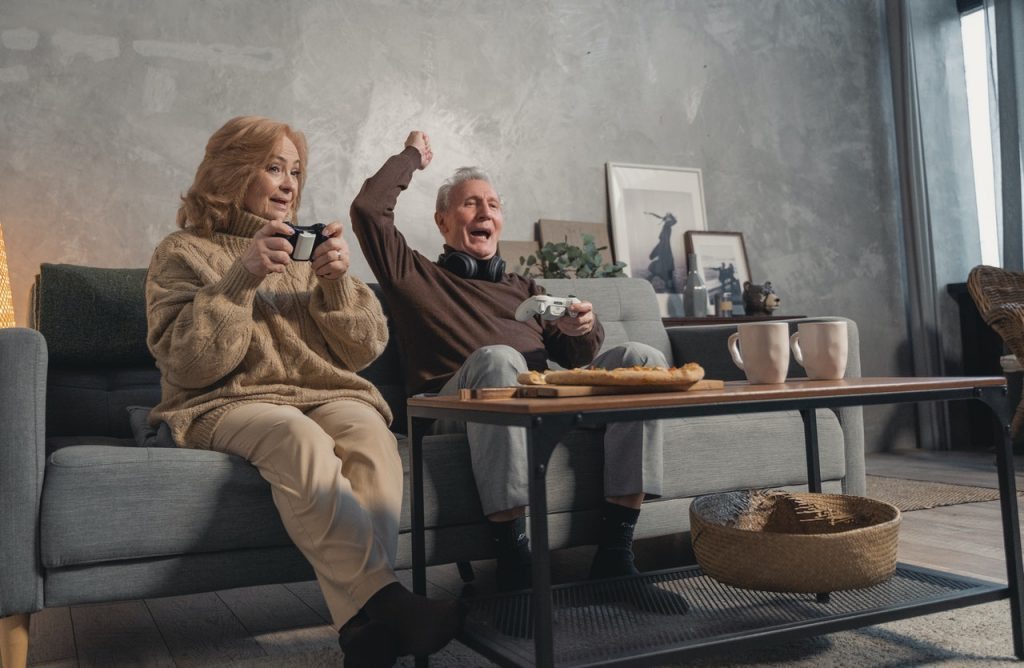 Elderly couple playing video games