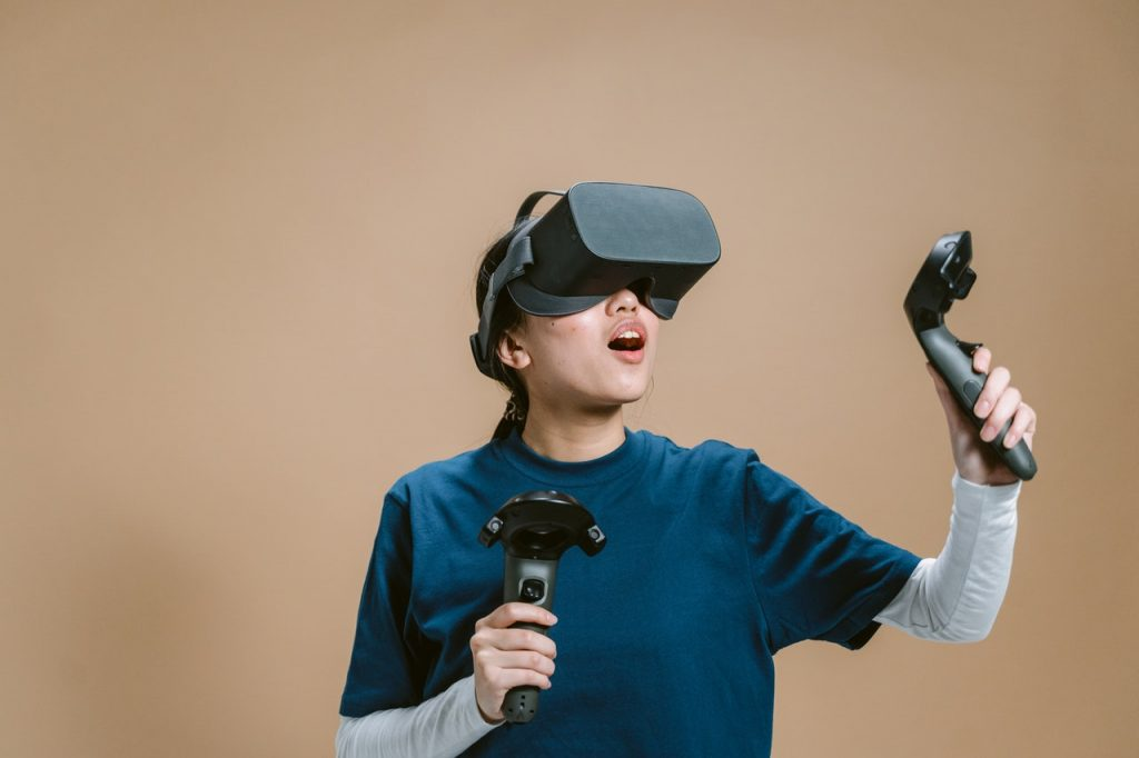 Woman playing using VR technology